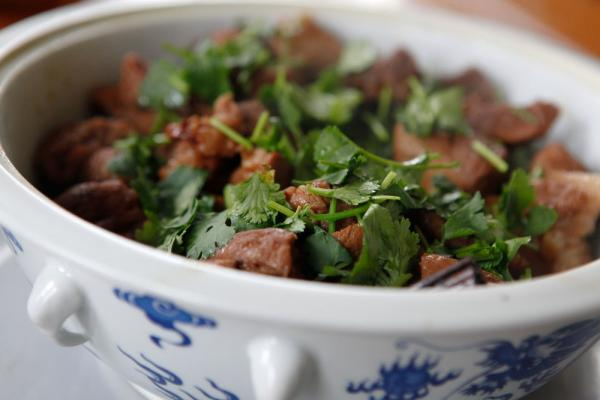 Cherry Coke-braised pork, a twist on the traditional soy-braised pork.