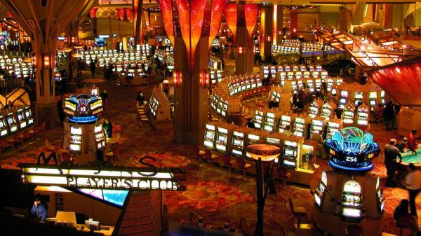 Gamblers play on some of the more than 6,000 slot machines at Mohegan Sun in Uncasville, Conn. The casino is owned and operated by the Mohegan Tribe.