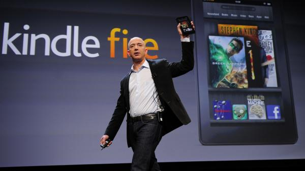 Amazon CEO Jeff Bezos introduces the new Kindle Fire tablet in New York, on September 28, 2011. The Fire's strong holiday sales were part of a trend that now has nearly a third of all American adults owning an e-book reader or tablet computer.