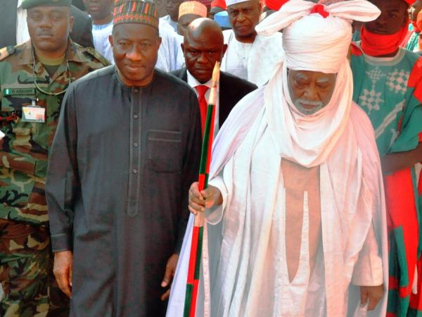 Nigerian President Goodluck Jonathan (left) walks with the Emir of Kano Ado Bayero during a one-day visit to the city that was rocked by recent attacks.