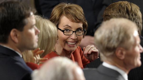 Retiring Rep. Gabrielle Giffords, D-Ariz. smiles on Capitol Hill in Washington, prior to President Barack Obama's State of the Union address.