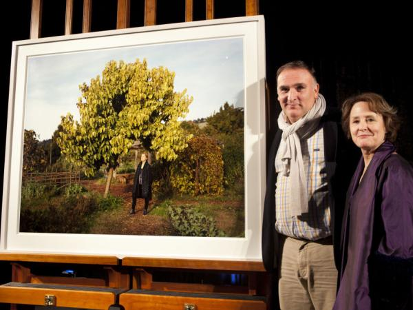 Chefs Jose Andres and Alice Waters pose along side her newly installed portrait, by photographer Dave Woody, at the National Portrait Gallery in Washington, on Jan. 20, 2012.