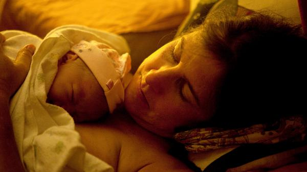Shannon Earle holds her new baby Kiera Breen Earle, moments after she was born at their home last year.