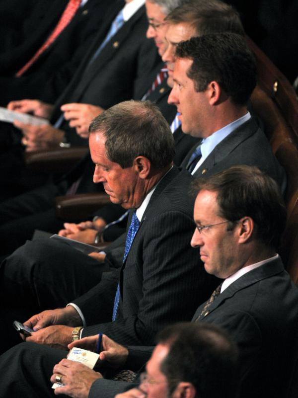 Rep. Joe Wilson, a Republican from South Carolina, checks his phone after yelling out during President Obama's speech on health care before a joint session of Congress on Sept. 9, 2009.