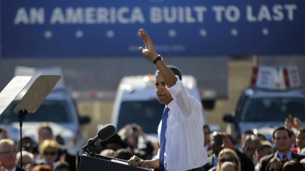 President Barack Obama waves after speaking at a UPS facility in Las Vegas on Thursday. Nevada is one stop on the president's latest road trip focusing on the economy.