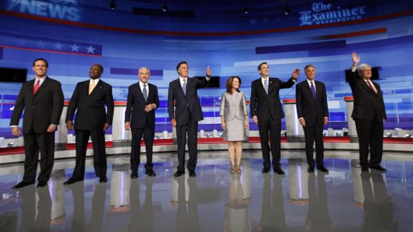 A large field of GOP presidential contenders debated each other at Iowa State University in Ames, IA. From left, Rick Santorum, Herman Cain, Ron Paul, Mitt Romney, Michele Bachmann, Tim Pawlenty,Jon Huntsman and Newt Gingrich.