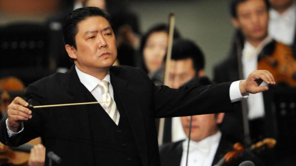 An unmussed conductor Long Yu in a 2008 file photo taken in Vatican City.