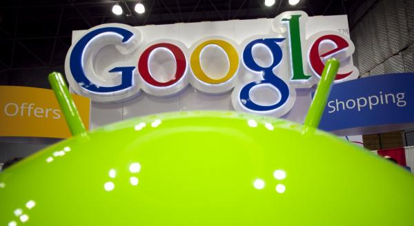 A sign for Google is displayed behind the Google android robot, at the National Retail Federation, in New York. The announced changes to Google's privacy policy has drawn both positive and negative attention.