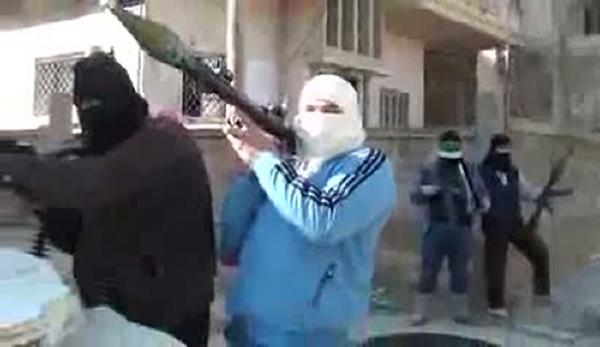 An image grab taken from a video uploaded on YouTube on Sunday shows armed men who are said to be members of the Free Syrian Army.