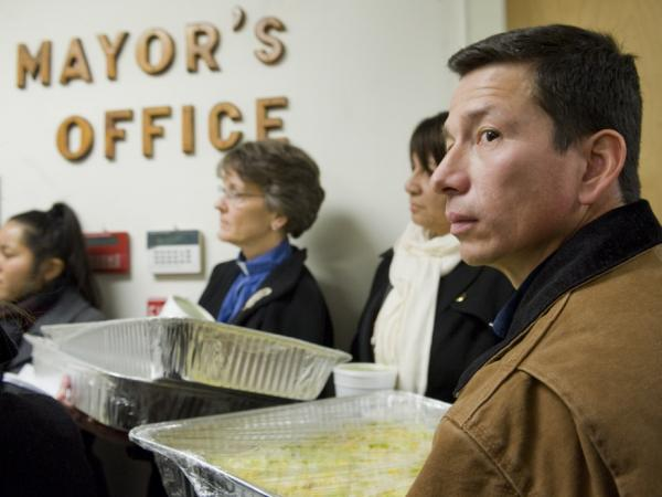 Dixon Jimenez (right), delivers tacos with other activists to Mayor Joseph Maturo Jr. in East Haven, Conn., on Jan. 26. Maturo was not in his office to receive the tacos.