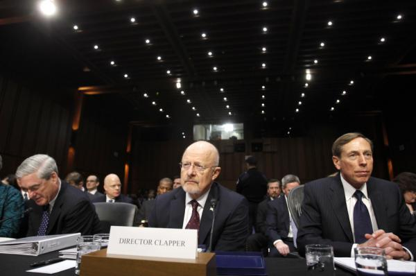 From left, FBI Director Robert Mueller, Director of National Intelligence James Clapper, and CIA Director David Petraeus take their seats on Capitol Hill in Washington on Tuesday, prior to testifying before the Senate Intelligence Committee hearing.