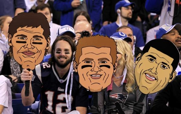 New England fan Nick Lower holds up cartoon cutouts with the likenesses of Patriots players Tuesday ahead of Super Bowl XLVI against the New York Giants in Indianapolis.