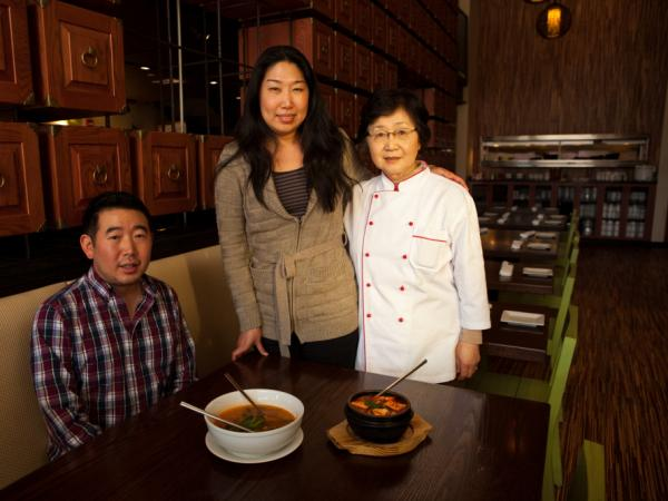Danny Lee, Jean Lee and their mother, Yesoon Lee, cook home-style Korean soups at their Mandu restaurants in Washington, D.C.