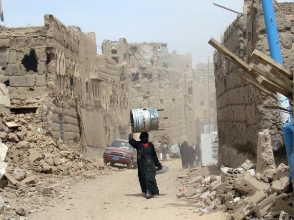 A Yemeni woman walks through a heavily damaged neighbourhood in the war-battered city of Saada, 240 kms (150 miles) north of the Yemeni capital Sanaa, on March 8, 2010, one month after a truce was declared between the Shiite rebels and government forces. Dammaj, in Saada province, is currently outside of effective Yemeni government control.