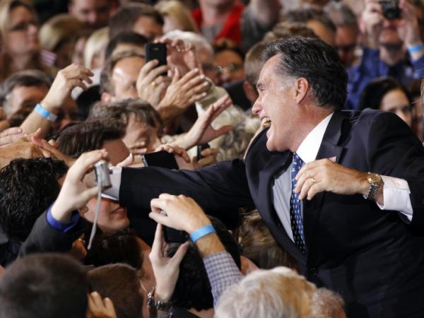 Former Massachusetts Gov. Mitt Romney celebrates his Florida primary election win at the Tampa Convention Center on Tuesday.