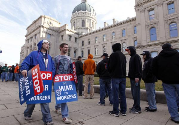 Union members protesting the right-to-work legislation wait to enter the Statehouse in Indianapolis on Wednesday.
