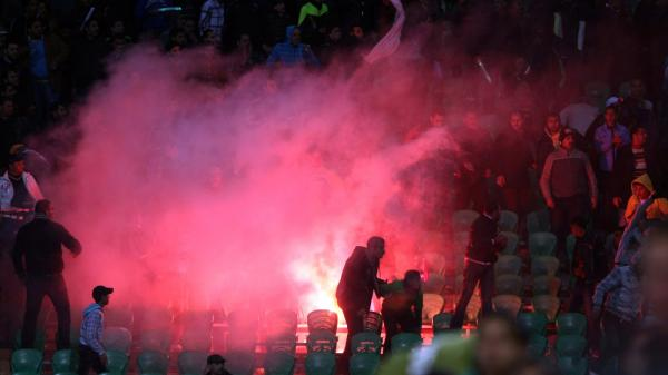 Flares were thrown in the stadium during clashes that erupted after a football match between Egypt's Al-Ahly and Al-Masry teams in Port Said.