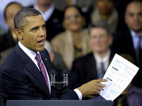 President Obama holds a proposed mortgage application in Falls Church, Va., Wednesday, Feb. 1, 2012.