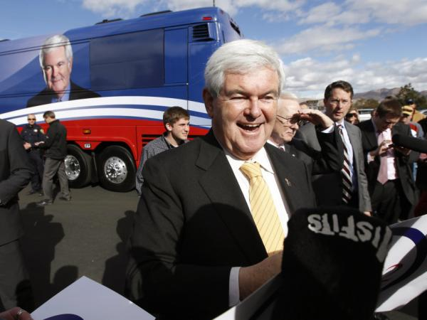 Newt Gingrich greets supporters during a campaign appearance at a restaurant in Reno, Nev., on Wednesday. He said Thursday he will challenge Florida's winner-take-all scheme for awarding delegates.