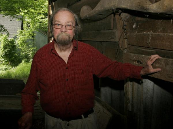 Donald Hall stands in the barn of the 200-year-old Wilmot farm that has been in his family for four generations. His latest poetry collection is called <em>The Back Chamber.</em>