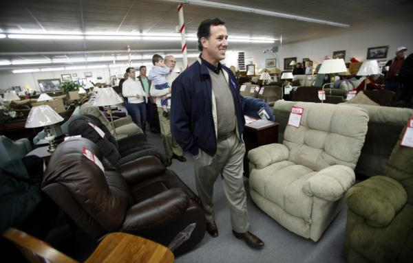 Republican presidential candidate Rick Santorum walks among recliners during a campaign stop at a furniture store in Iowa in December. Recliner sales have been rising fast leading up to the Super Bowl.