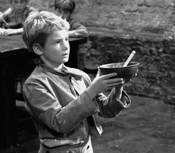 Poor orphan Oliver Twist was one of the 989 named characters Dickens created during his prolific career. Above, Mark Lester asks for more gruel during the 1967 filming of <em>Oliver!</em>