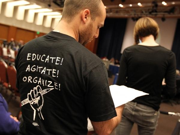 A student prepares to speak in opposition to proposed tuition increases at a University of California Board of Regents meeting in July 2011.