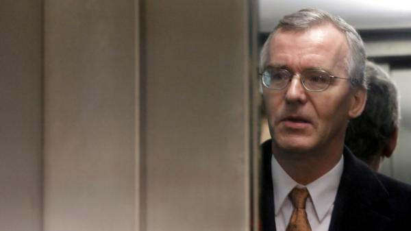IMF representative Bob Traa is seen inside an elevator as he arrives a government office building before meeting Greek Finance Minister Evangelos Venizelos in Athens on Monday.