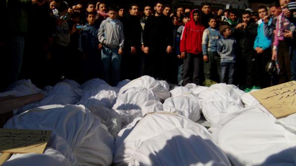 Syrians attend a Feb. 4 burial ceremony of what activists say are victims of shelling by the Syrian army in the central city of Homs. The city has been the scene of the bloodiest fighting in Syria in recent days.