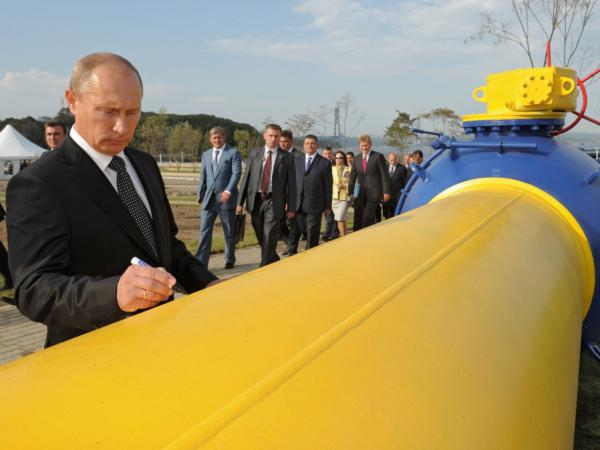 Russia's Prime Minister Vladimir Putin signs an autograph on a natural gas pipeline Sakhalin-Khabarovsk-Vladivostok in the Russian Far East city of Vladivostok on Sept. 8, 2011. Parts of Europe have struggled with arctic temperatures this winter and rely on gas piped in from Russia.
