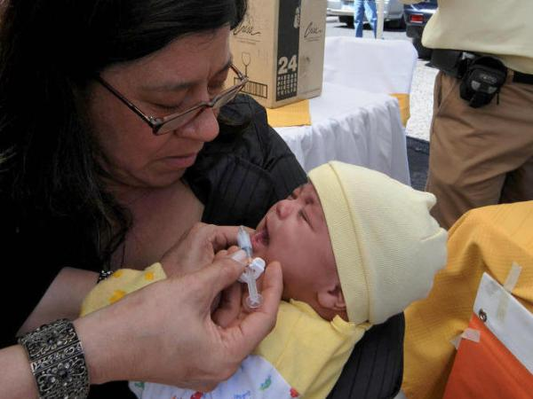 A baby is inoculated against rotavirus in Honduras in early 2009.