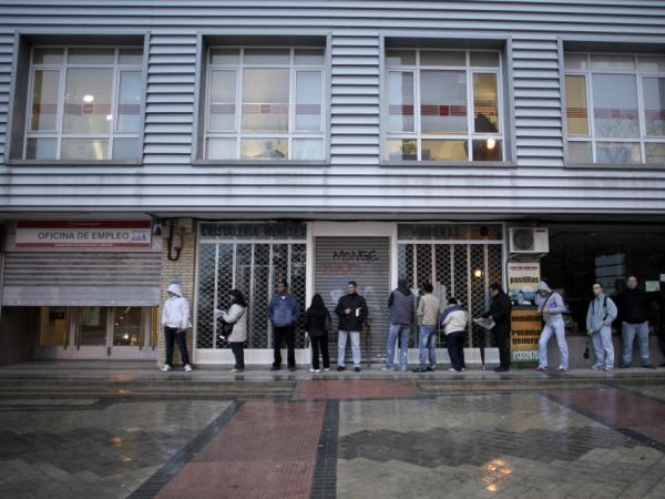 People queue outside an unemployment registry office in Madrid, Dec. 2, 2011. One in four Spaniards is out of work; about half of Spaniards in their 20s are jobless.