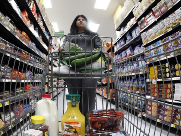 A shopper walks down an aisle in a newly opened Walmart Neighborhood Market in Chicago.