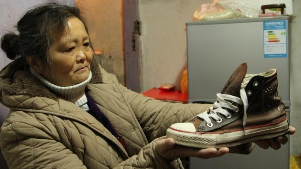Chuck Taylor All Stars are common on the streets of Shanghai. Xuan Zhihui, 62, a retiree from a state-owned factory, wears her daughter's hand-me-down sneakers, which are 15 years old. She says they're really comfortable.