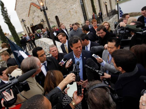 Republican presidential candidate Rick Santorum talks with members of the media during a campaign event held on Feb. 8, 2012 in McKinney, Texas. Rick Santorum swept all three Republican voting contests last night in Colorado, Minnesota and Missouri.