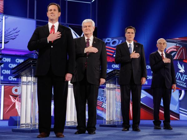 GOP presidential candidates (from left) Rick Santorum, Newt Gingrich, Mitt Romney and Ron Paul place their hands over their hearts during the national anthem at the start of a debate in Florida last month.