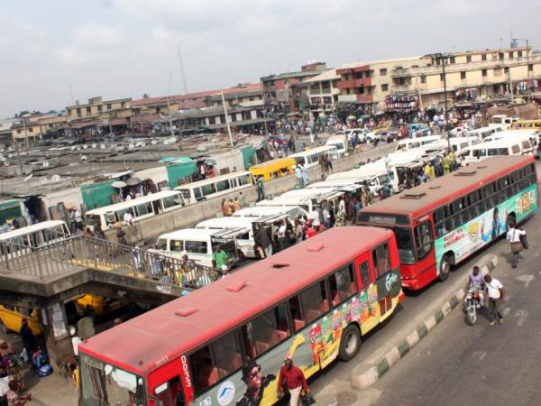 Buses and vans are seen near Oshodi market in Lagos on Feb. 1, 2012. A nationwide strike and protests brought tens of thousands into the streets in Nigeria over fuel prices in January. Nigerians are now left coping with high petrol prices despite large fuel reserves. Resource wealth often leads to corruption.