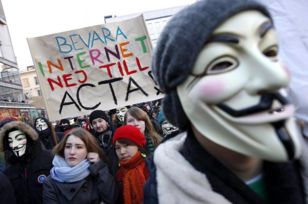 Protesters, some wearing Guy Fawkes masks, take part in a demonstration in Stockholm on Saturday to protest the Swedish government's plan to ratify the Anti-Counterfeiting Trade Agreement.