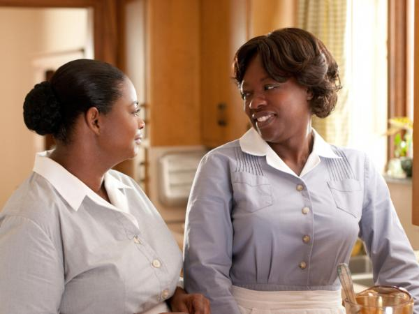 Minny (Octavia Spencer) and Aibileen (Davis) are two domestics who team up with a writer to break the code of silence about the conditions they work under in 1960s Mississippi.