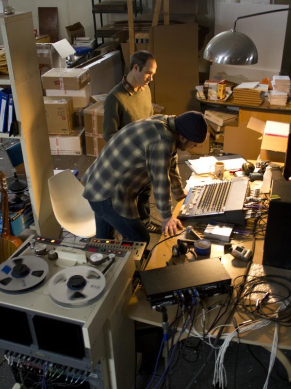 Joyner (rear) at work in his warehouse studio with guitarist Mike Friedman.