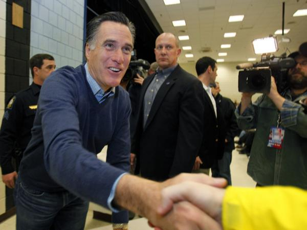 Republican presidential candidate Mitt Romney greets supporters at a caucus in Portland, Maine, on Saturday.