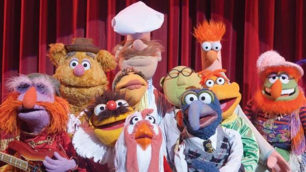 The cast of <em>The Muppets</em> includes (left to right) Floyd Pepper, Fozzie Bear, Lew Zealand, Janice, Swedish Chef, Camilla The Chicken, Dr. Bunsen Honeydew, Gonzo, Scooter and Beaker.