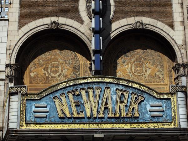 A former grand theater lies closed April 17, 2009 in Newark, New Jersey. Newark is struggling to hold onto economic gains made over the last decade. Its once vibrant downtown is filled with empty buildings.