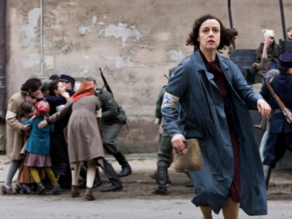 Paulina Chiger, played by Maria Schrader in Holland's film <em>In Darkness</em>, flees from Nazis rounding up Jews on the streets of Lvov. Chiger's daughter Krystyna tells NPR that the film is an<em> </em>accurate portrayal of how Leopold Socha sheltered her family in the city's sewers.