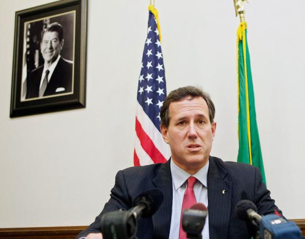 Republican presidential candidate Sen. Rick Santorum speaks to the media on Monday at the state capitol in Olympia, Washington.