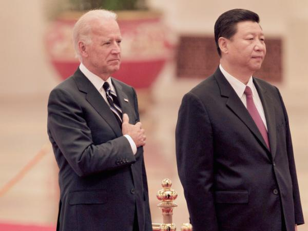Chinese Vice President Xi Jinping and U.S. Vice President Joe Biden listen to the U.S. national anthem during a welcoming ceremony inside the Great Hall of the People on August 18, 2011 in Beijing, China. Xi Jinping is the designated successor to president Hu Jintao.
