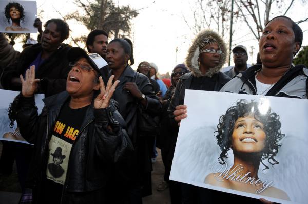 Fans attend a Whitney Houston Leimert Park Vigil on Monday in Los Angeles.