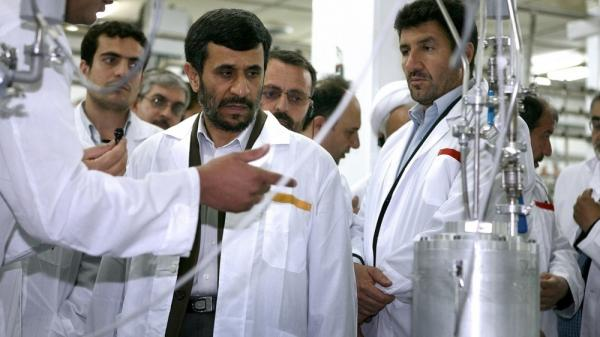 Despite international pressure, Iranian President Mahmoud Ahmadinejad listens to a technician during a visit to the Natanz Uranium Enrichment Facility, 200 miles south of the capital, Tehran, in 2008.