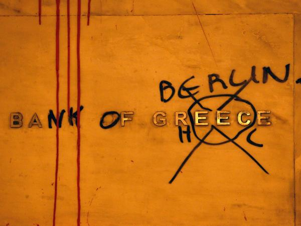 "Protesters have ""renamed"" the Bank of Greece in honor of Germany, which many Greeks see as having undue influence over economic decisions in their country. The sign is seen in Syntagma Square on Feb. 12, 2012 in Athens, Greece."