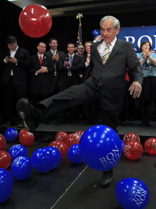 Republican presidential candidate Ron Paul kicks a balloon into the crowd at his Maine caucus night rally in Portland on Feb. 11.